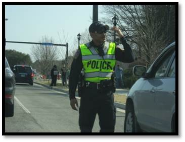 police cadet directing traffic