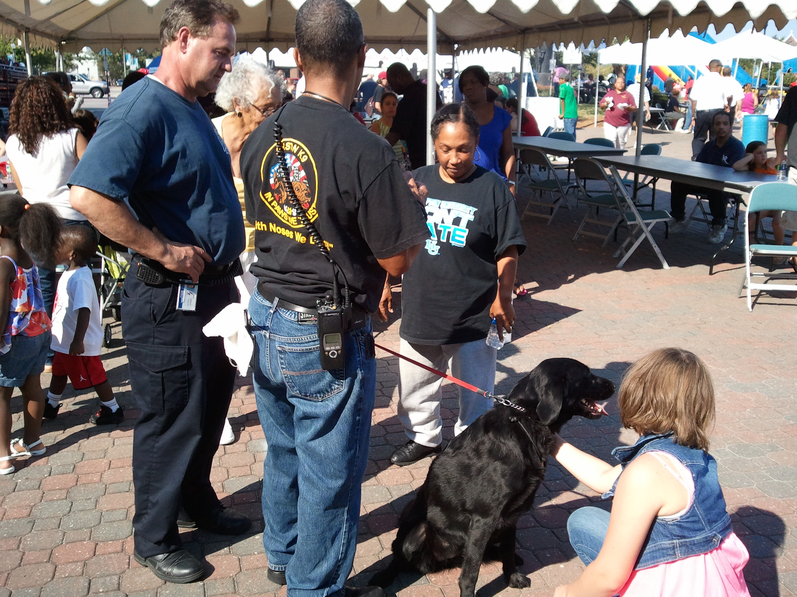 Firefighter S.Brown and Investigator Gomes with Accelarant dog Taylor