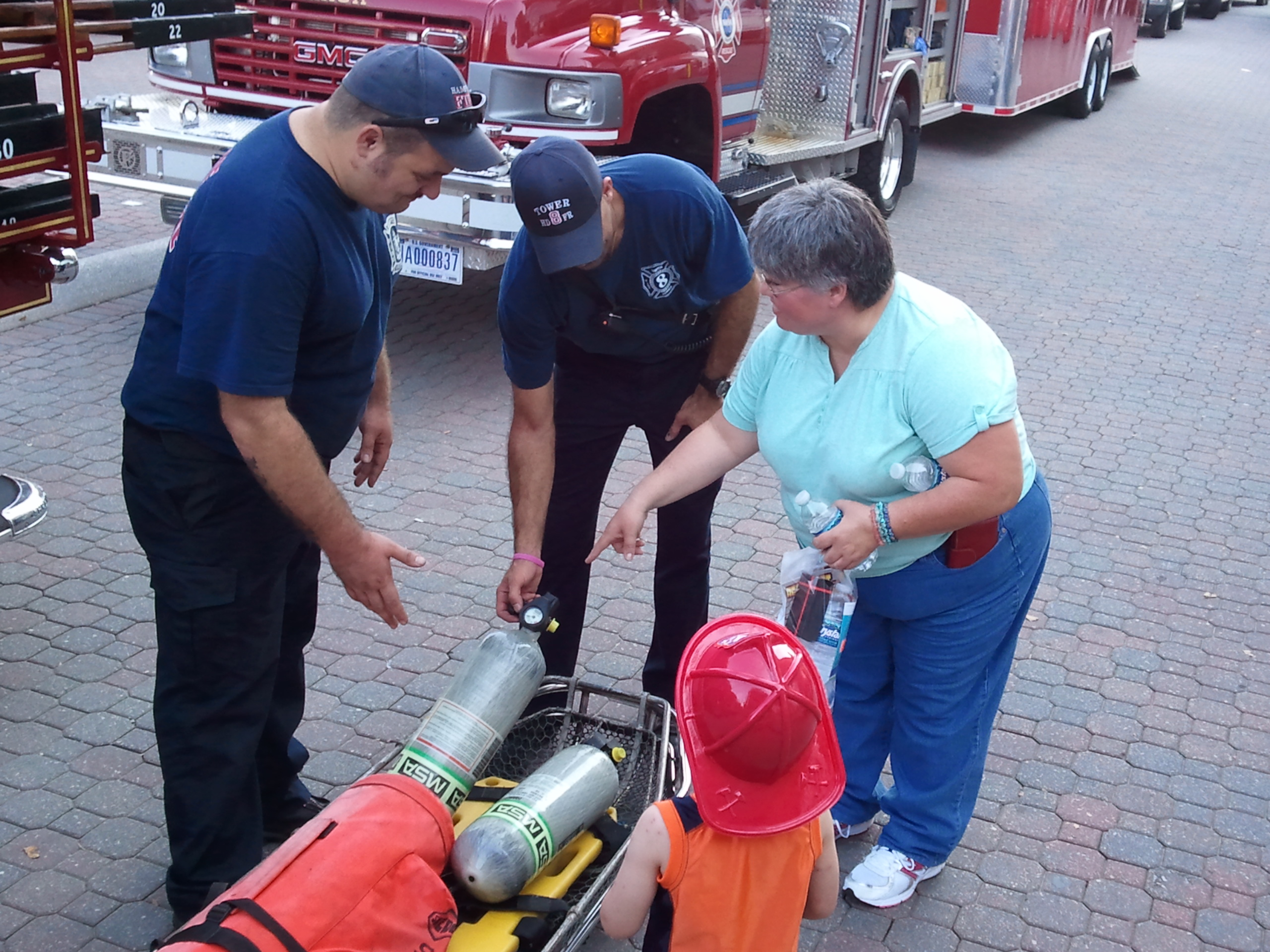 Firefighters talk with festival-goers